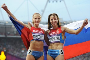 12 Aug 2012, UK --- ITAR-TASS: LONDON, GREAT BRITAIN. AUGUST 12, 2012. Gold medallist Russia's Mariya Savinova (R), bronze medallist Russia's Ekaterina Poistogova celebrate their medals in the women's 800m final at the London 2012 Olympic Games. (Photo ITAR-TASS/ Valery Sharifulin) --- Image by © Sharifulin Valery/ITAR-TASS Photo/Corbis