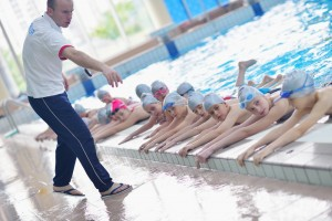 Group,Of,Happy,Kids,Children,At,Swimming,Pool,Class,Learning